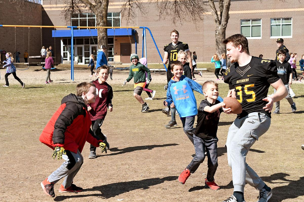 Dordt Defenders play with Christian school students