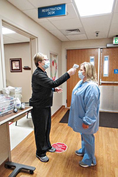 Sanford Sheldon staff temperature check