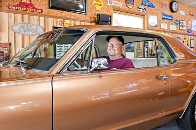 Kinrade behind the wheel of Cougar