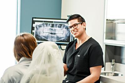 Leo Marquez talking to dental patient