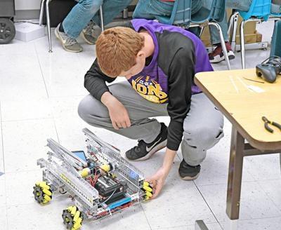 Cody Huisman checks robot