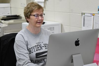 Rhonda Petitt works at Boyden-Hull desk