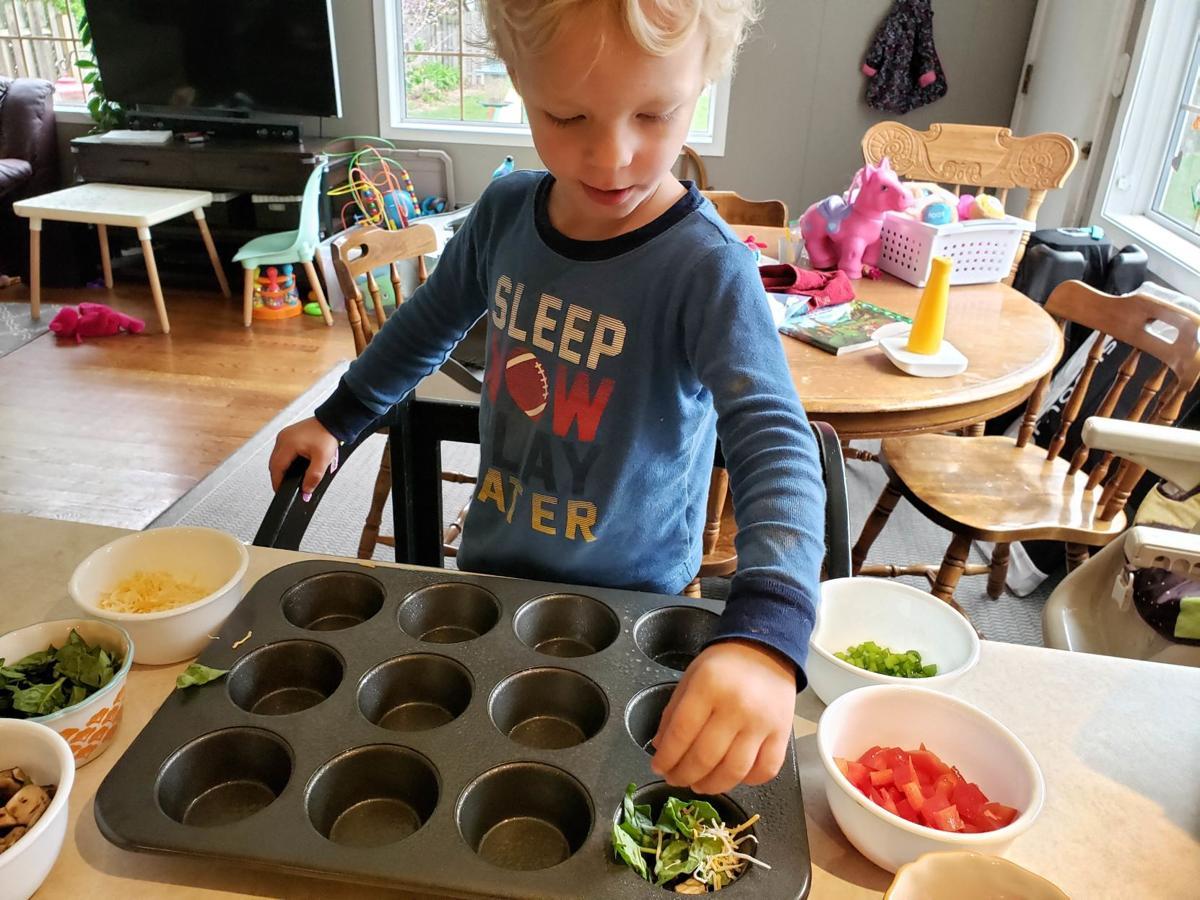 Harrison making omelette muffins