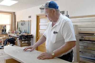 Orlan Gulker examines wooden plank