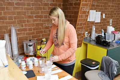 Abbe prepares shake at 712 Nutrition