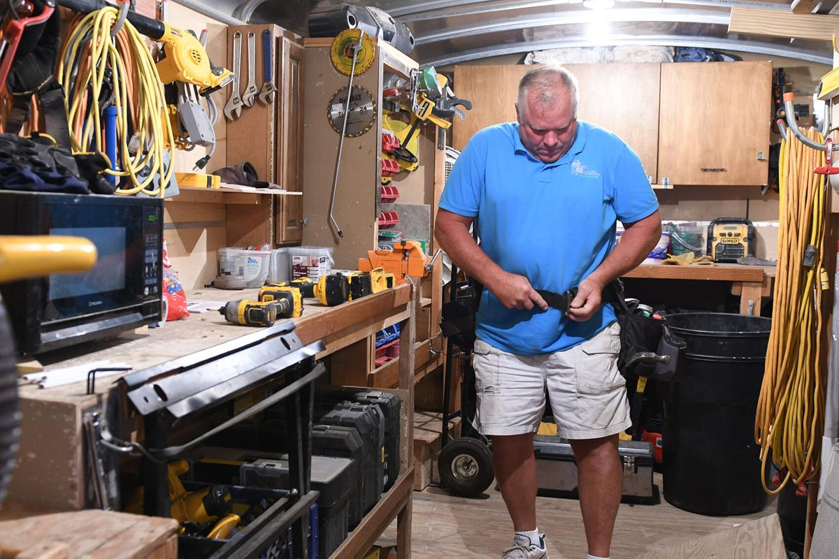 Marv Maassen puts on tool belt