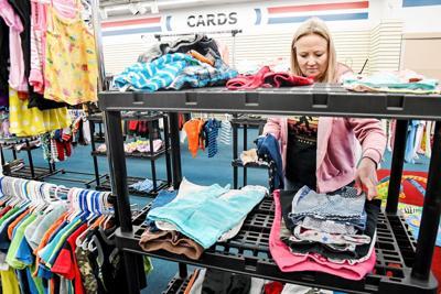 Mari Howard shelves donations in Hartley