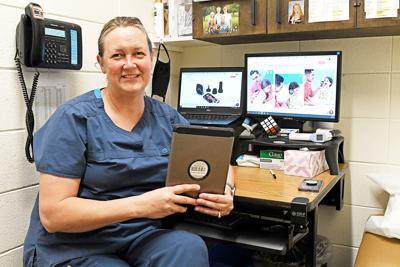 Sarah TeGrotenhuis with an iPad
