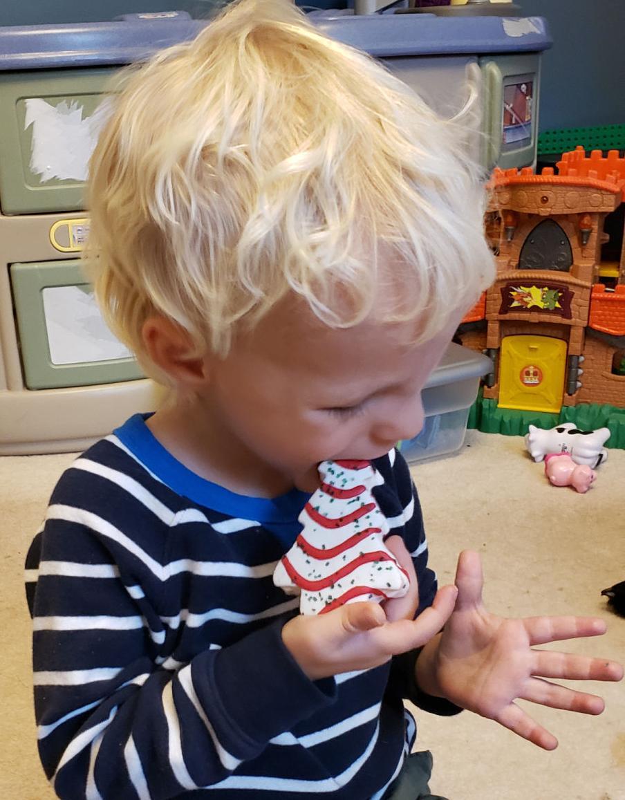 Harrison eating Little Debbie Christmas Tree