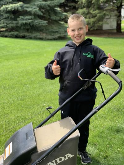 Lawn company surprises youth on home turf