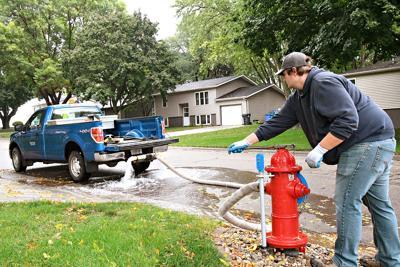 Zach Boneschans flushes fire hydrant