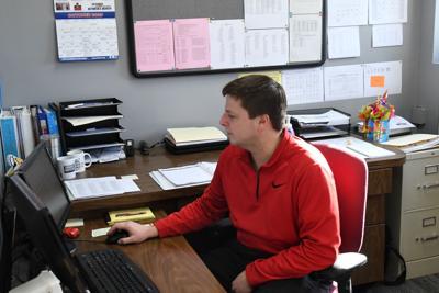 Tyler Glanzer works at desk in George