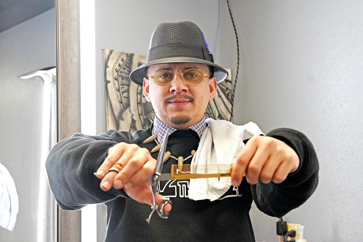 Rafael Maldonado opens barbershop