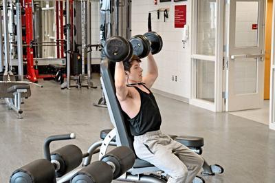 Titus Chapman lifts weights