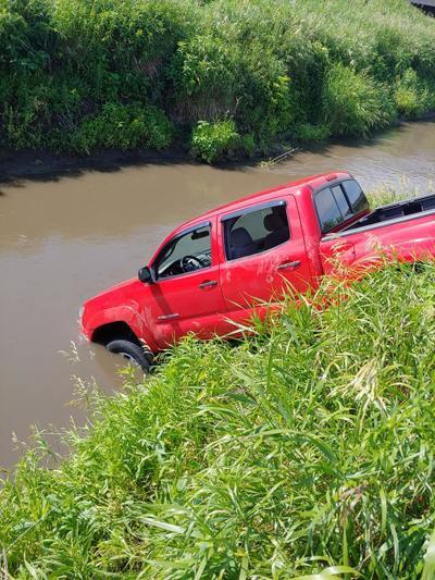 Pickup crashed into Dry Creek