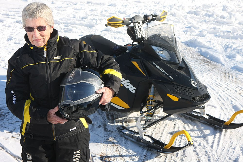 Zelda poses with snowmobile