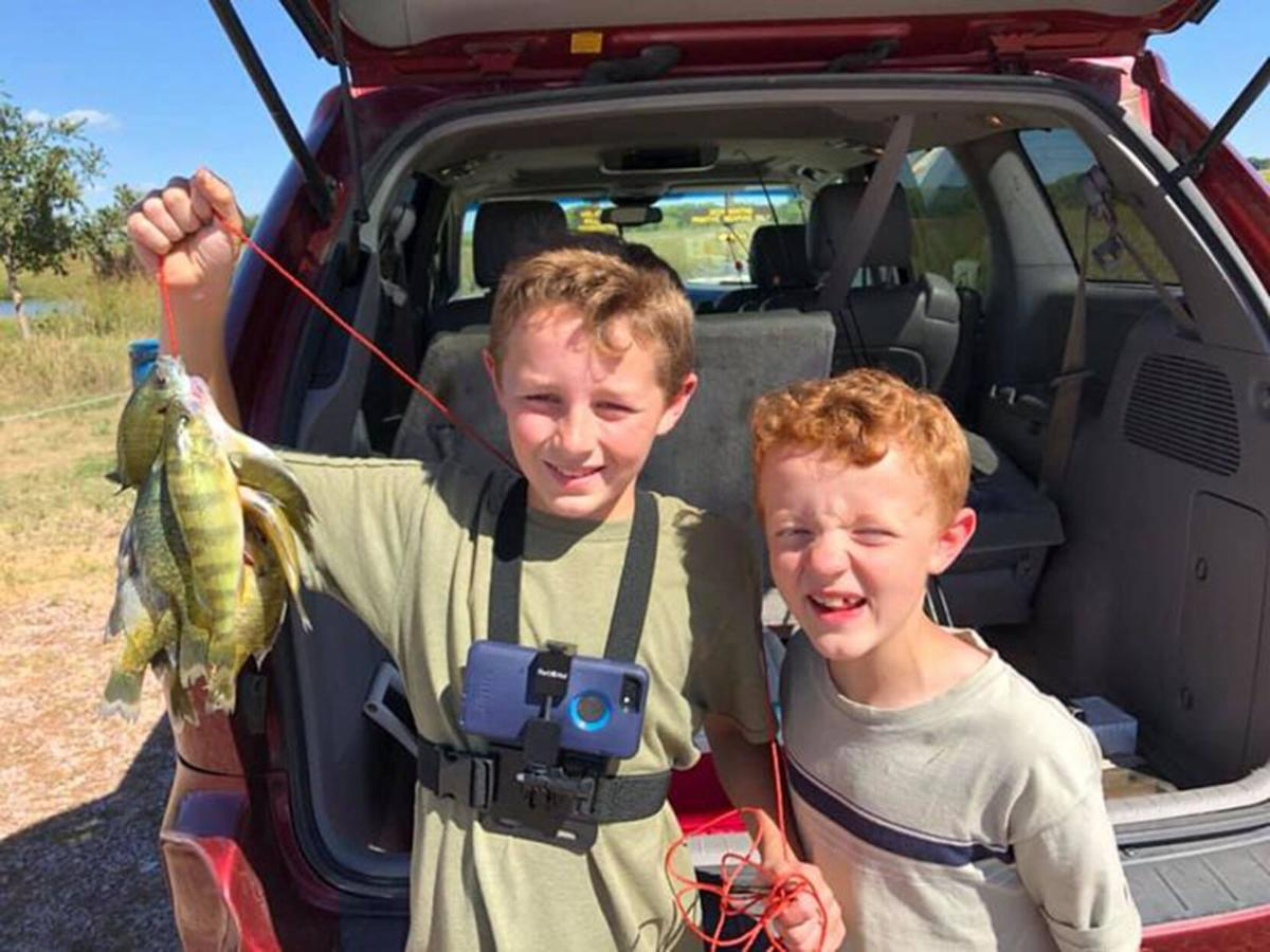 Rose brothers hold up their catch