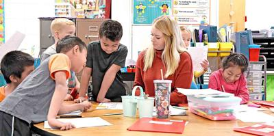 Kroese works with students