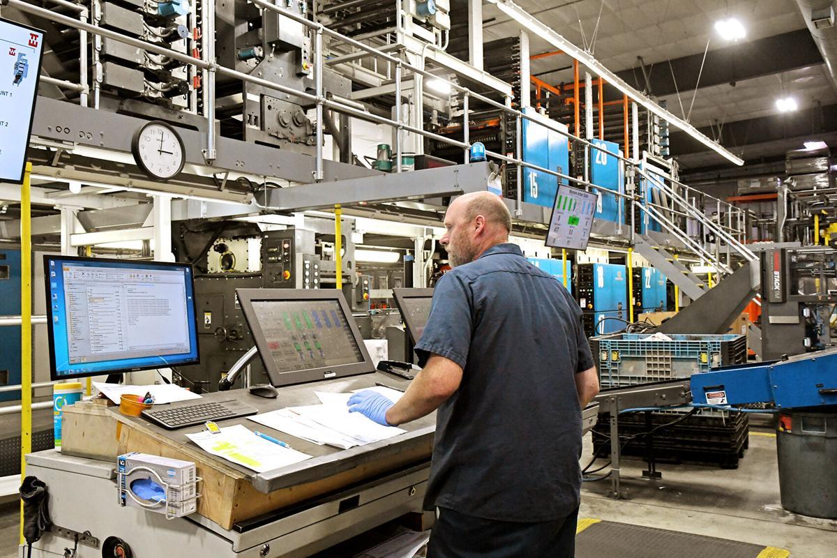 Mike Walker prepares press for print job