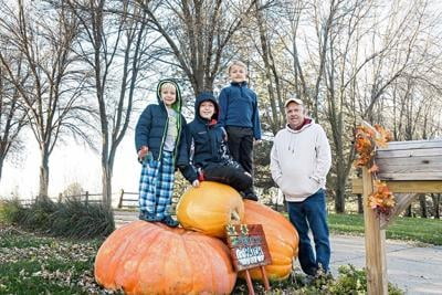 Rietema family with giant pumpkins