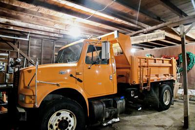 Archer snowplow truck in storage