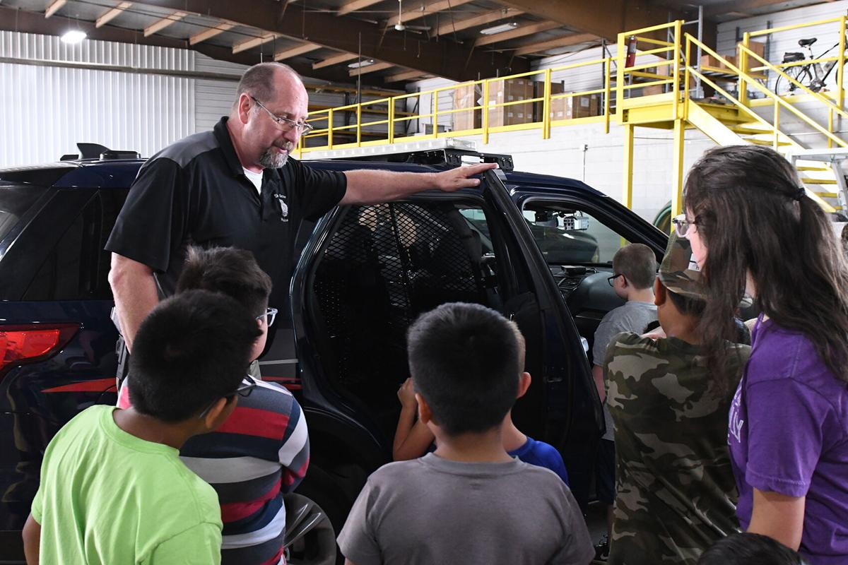Police chief Mike Halma shows car to kids