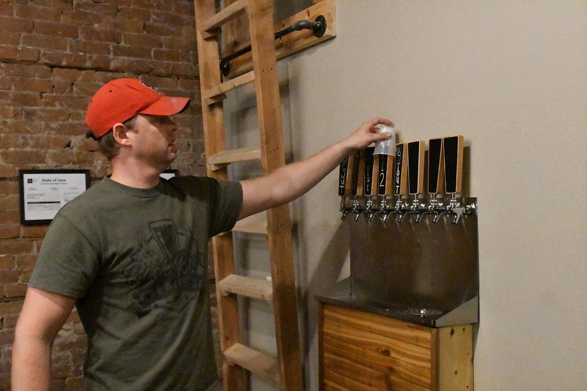 Dan Vander Zee reaches for beer tap