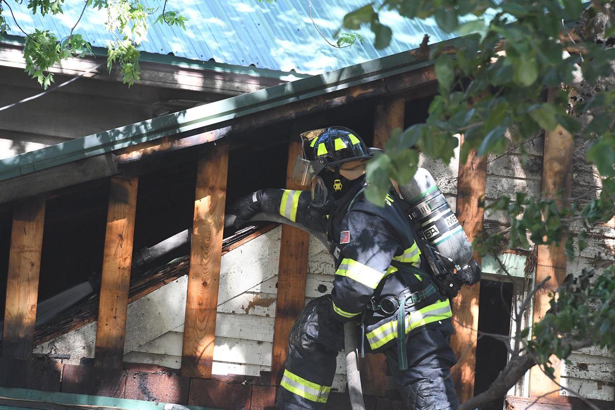 Firefighter hoses Archer house fire