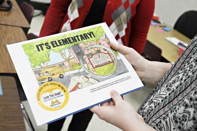 Danielle Kleinhesselink holds book