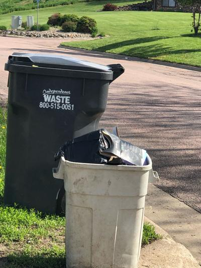 Hawarden garbage bags pile up