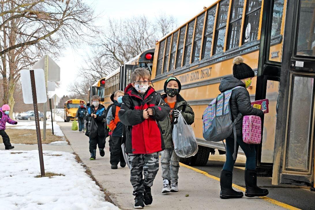 Sheldon elementary students board buses