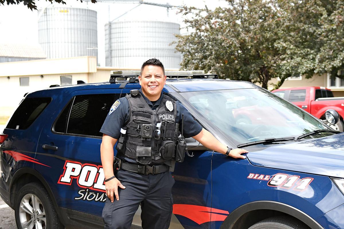 Agustin Martinez by police car
