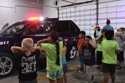 Kids check out Sioux Center police car sirens