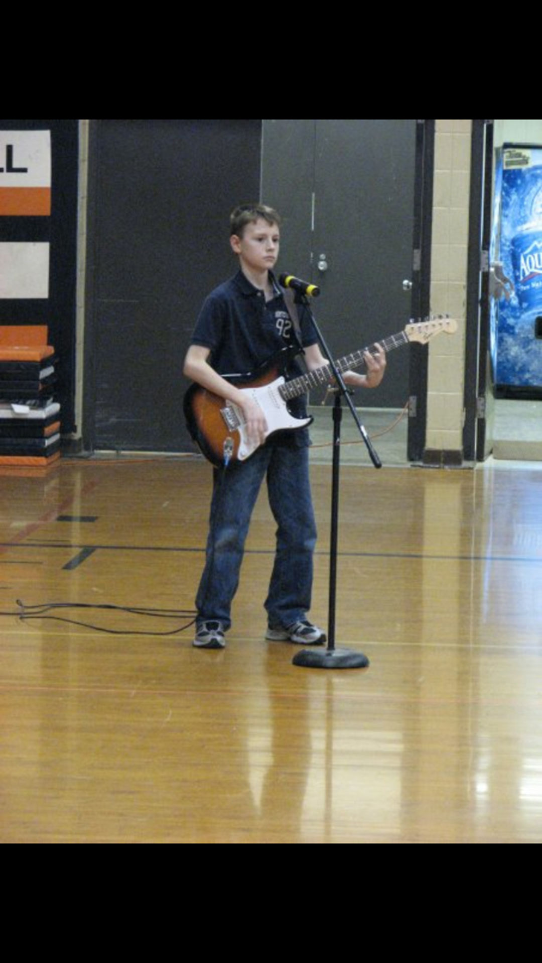 Randy playing guitar in middle school