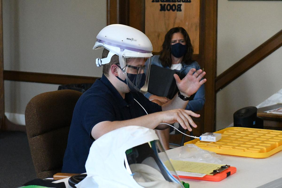 Jared Johnson demonstrates PPE