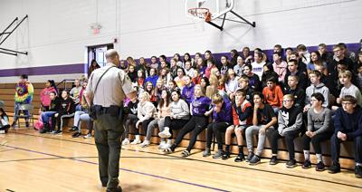 Deputy Pollema speaks to students