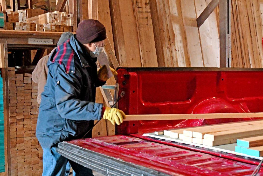 Dean Ackerman loads lumber