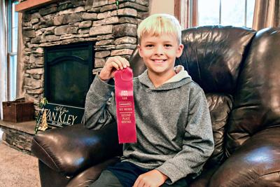 Caedrian Van Kley with whistling contest ribbon