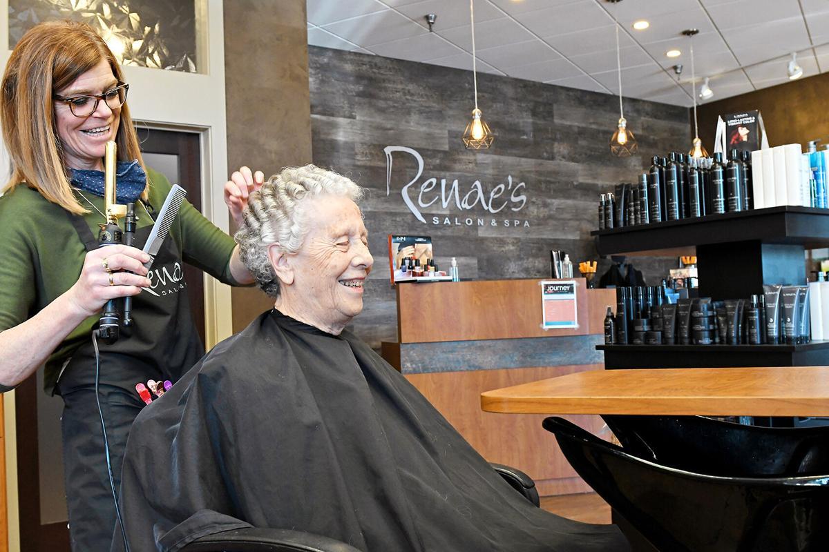 Renae Visscher works on client's hair