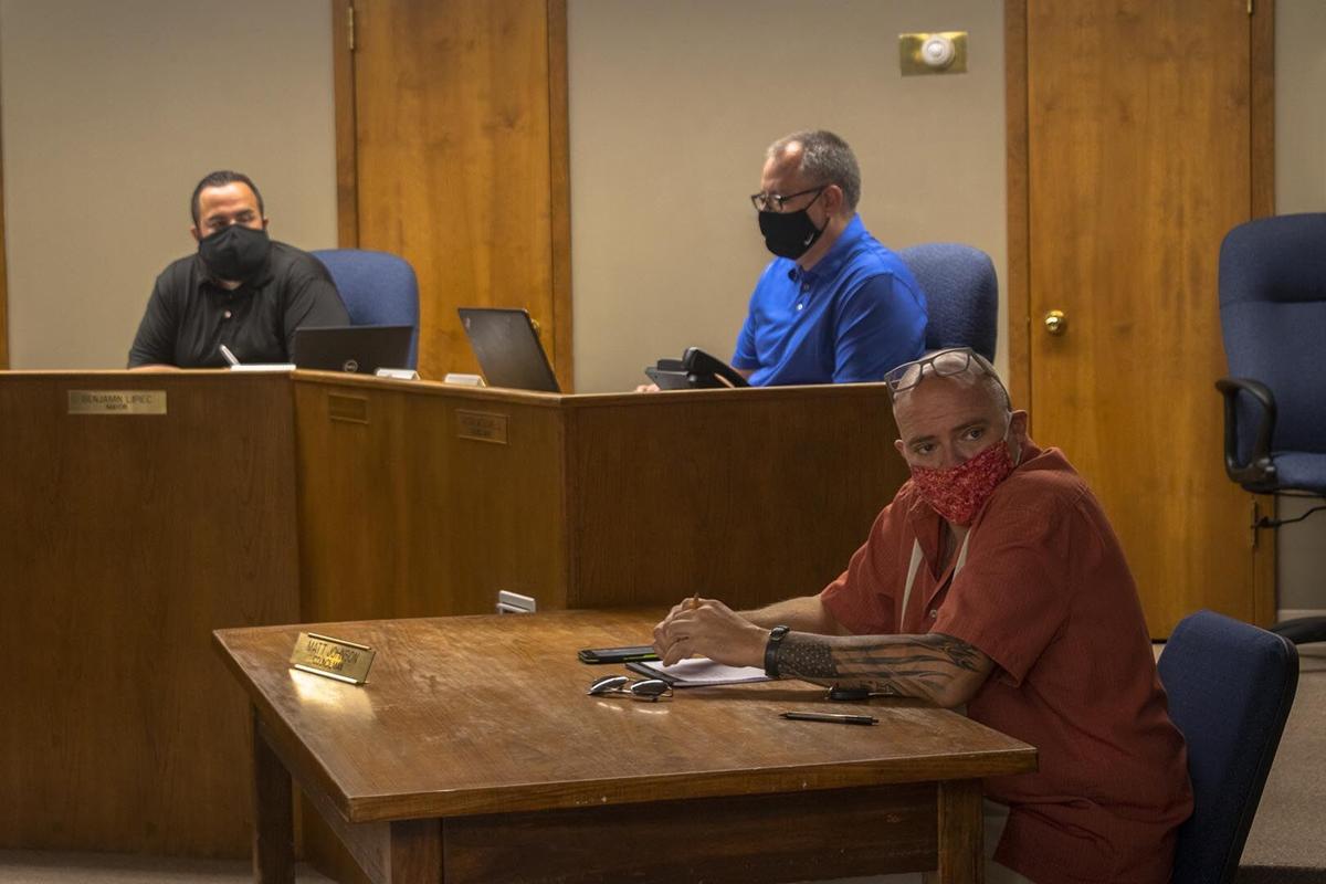 City Hall meeting- three men