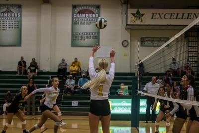 Girl setting ball MHS Volleyball