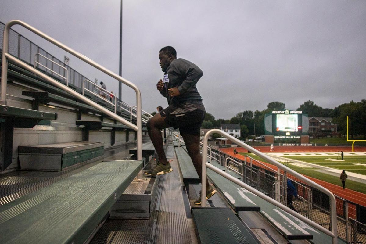 Kirayle Jones running up stairs