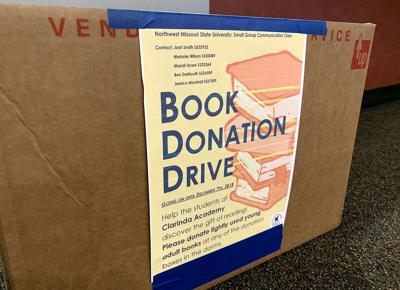 Communications class collect books for Clarinda Academy
