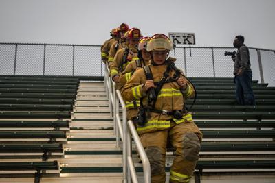 Firemen in a line- 9/11 stair climb
