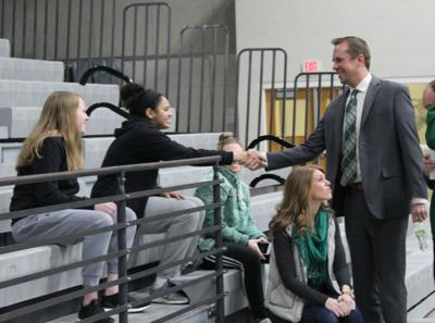 Meyer meets members of team