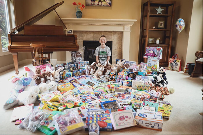 Young Woodinville boy donates a room full of toys to hospital