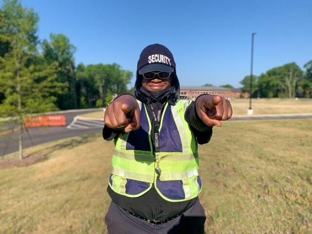 Drake Middle School crossing guard Kiiesha Tolbert strikes her signature pose