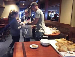 fears and garrison wetmore prepare bread and desserts for incoming diners at the 24th annual gary moore christmas meal hosted by red lobster in auburn - Red Lobster Open On Christmas