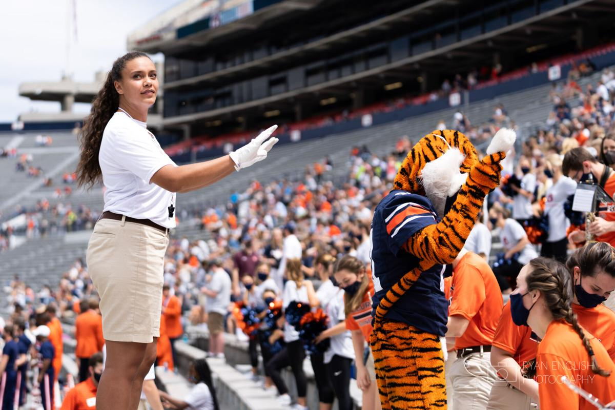 Brianna Jarvis co-conducts with Aubie the Tiger