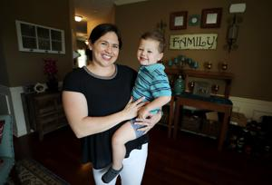 Auburn woman excels in dual roles — firefighter and mom